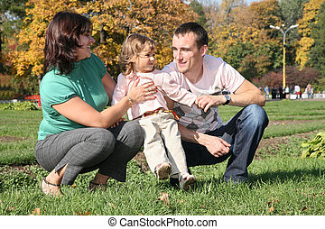 family with girl in park