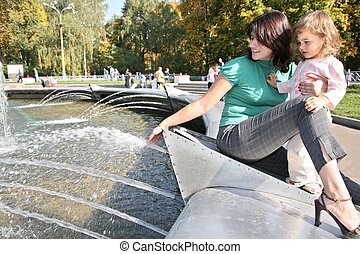 mother with the daughter at fountain