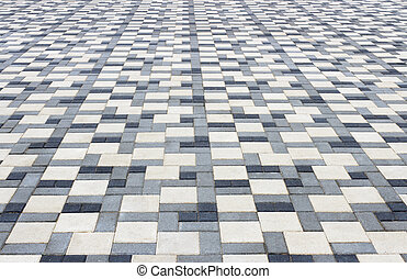 Paving tiles - Sidewalk in the park is paved with...