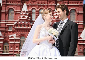 fiance and bride against the background of historical museum...
