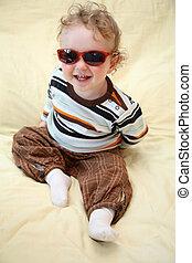 child in the sunglasses