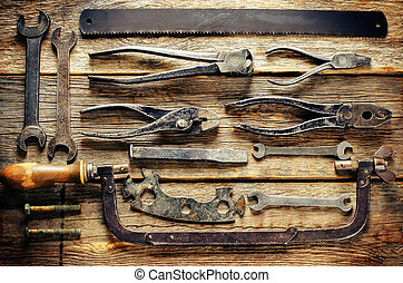 old tools on a dark wood background. tinting. selective...