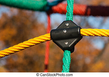 playground saftey rope - close up of a color playground...