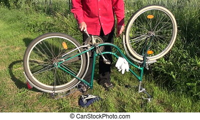 repair old bicycle on farm yard grass