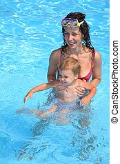 Mum and the son in pool