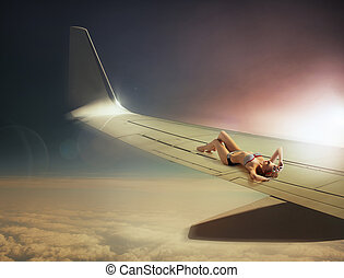 Conceptual photo of a traveling woman