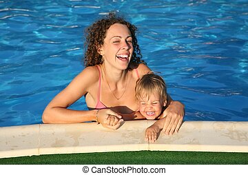 mother with the child in the pond