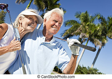 Happy Senior Man and Woman Couple Playing Golf - Happy...