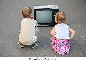 children on the road in the old television set