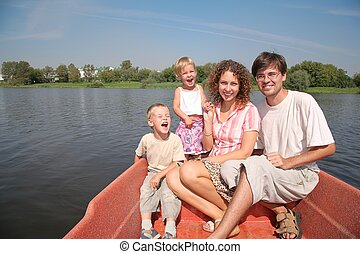 family with the children in the boat
