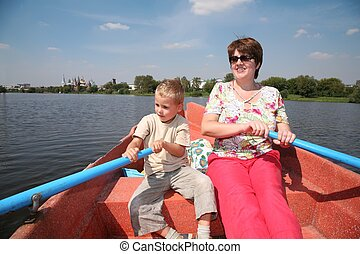 woman and boy in the boat with the oars