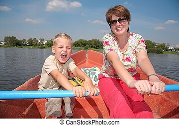 woman and boy in the boat with the oars 2