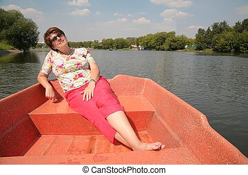 woman at the lake in the boat