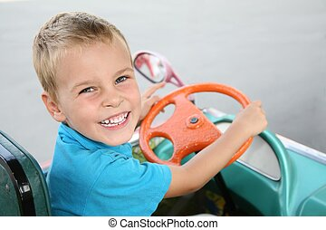 boy in toy car