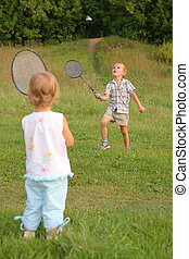 boy and girl play badminton