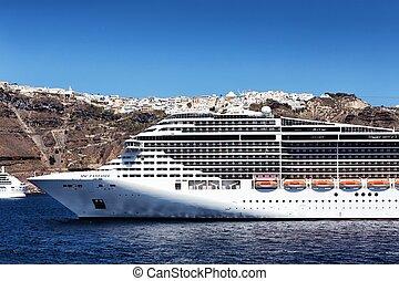 MSC Fantasia cruise ship near Santorini island in Aegean sea