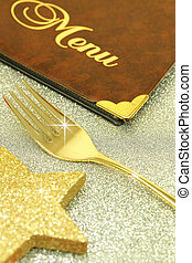 Golden fork and restaurant menu on festive background