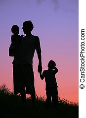 father and children on sunset