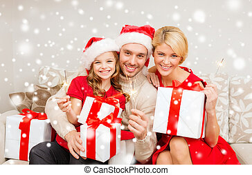 happy family with gifts and sparklers - christmas, holidays,...