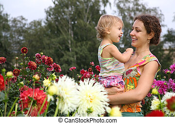 mother with baby in flowers
