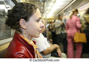 young woman in subway