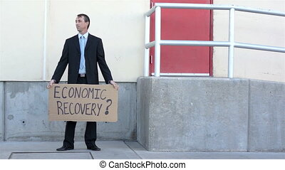 Businessman Economic Recovery Sign - Businessman wearing a...