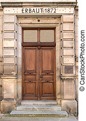 Old brown wooden door of a school - Old brown wooden door in...