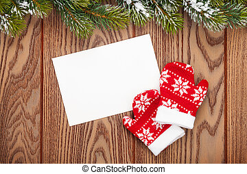 Christmas greeting card or photo frame and mittens over...