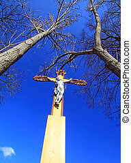 Jesus Christ on the cross and blue sky
