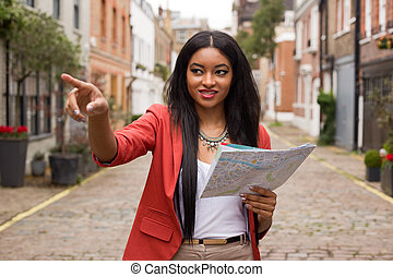 young woman pointing with a map