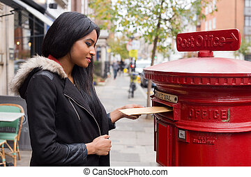 young woman posting letters.