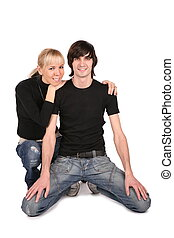 couple in black sits