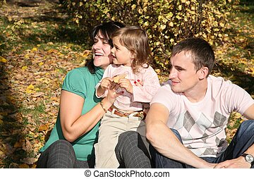 happy family in the park in autumn 2