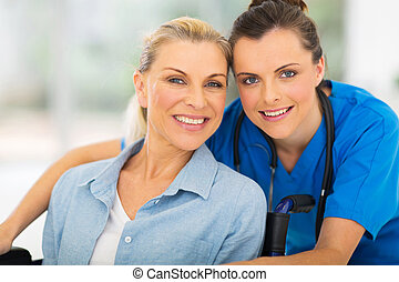 senior disabled woman and her caregiver