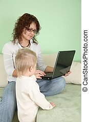 young woman in eyeglasses with notebook and child