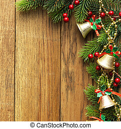 Decorated Christmas tree border on wood paneling with gold...