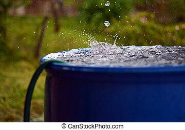 Overflow - Heavy rain makes the barrel flow over.