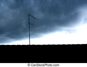 Storm and tv antenna - A rain droplets are falling down, a...