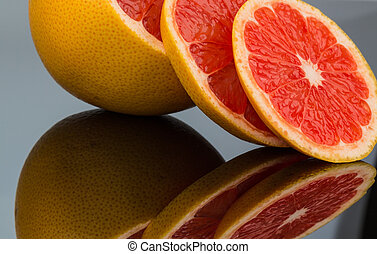 reflection of an orange. photo icon for healthy vitamins...