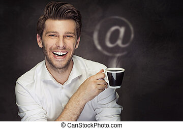 Conceptual picture of the man with coffee and the @ sign -...