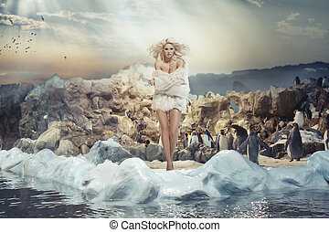 Alluring woman on the ice island with penguins