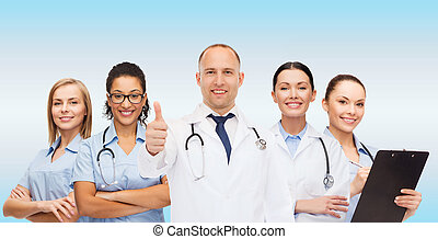 group of smiling doctors with showing thumbs up