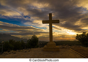 Cross - A huge stone cross against a dramatic sky