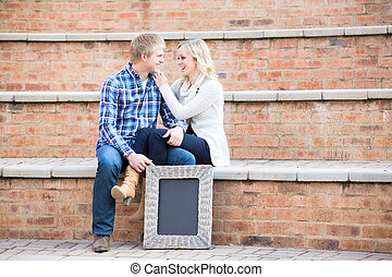 Attractive young caucasian couple smiling at each other