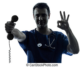 doctor man silhouette holding phone gesture