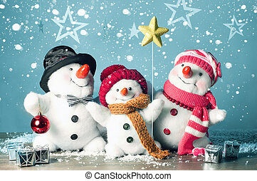 Happy snowman family in the snow