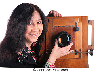 senior woman with old camera