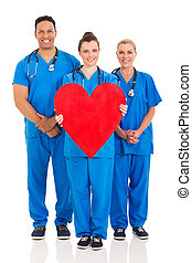 group of healthcare workers with heart symbol