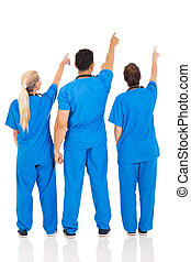 rear view of medical doctors pointing