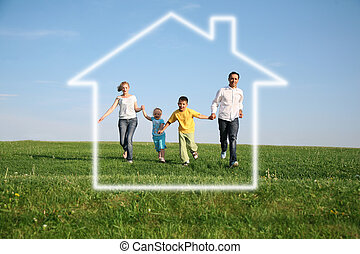 family of four in dream house